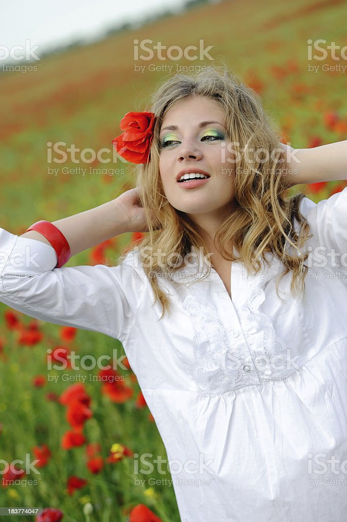 young woman portrait in red poppy meadow royalty-free stock photo
