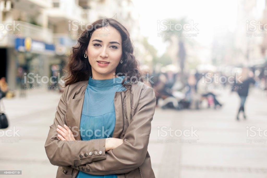 Young woman portrait in the street. stock photo