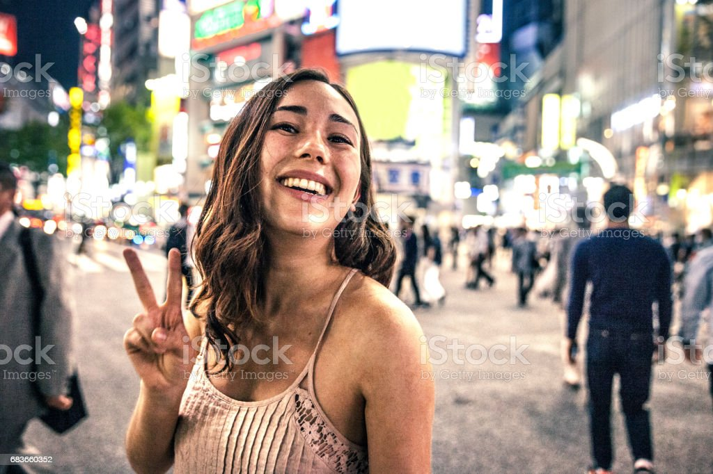 Young woman portrait in Tokyo downtown at night, Japan. stock photo