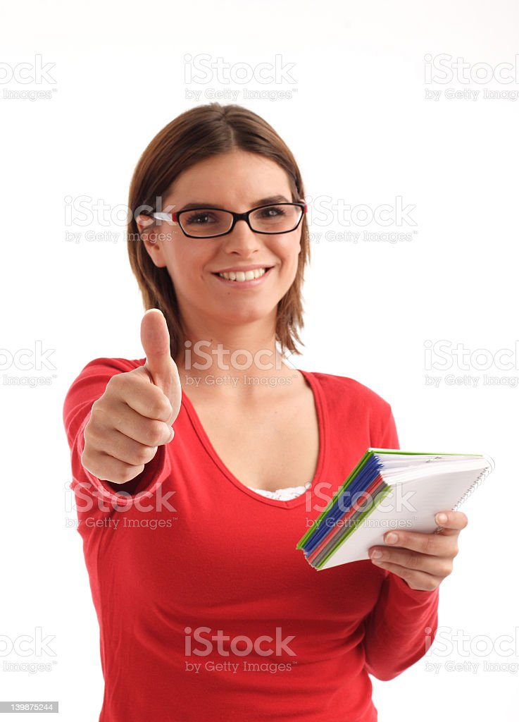 Young woman portrait with thumb up (focus on her hand) royalty-free stock photo