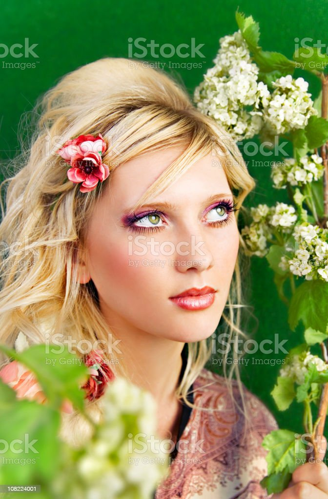 Young Woman Posing Amongst Spring Flower Branches royalty-free stock photo