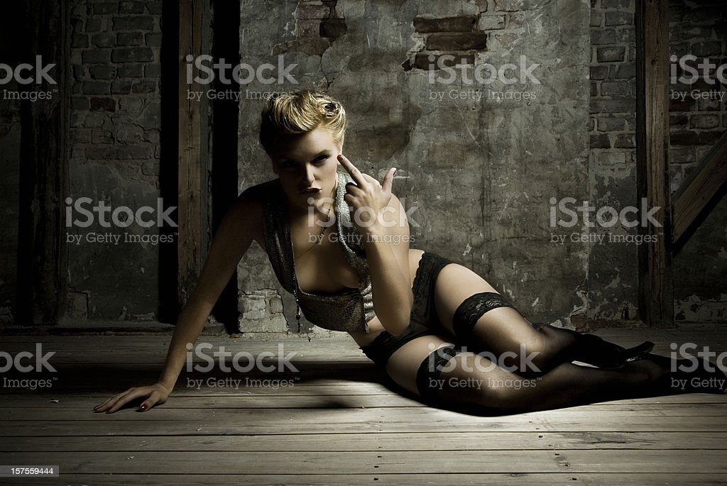 Young Woman Posing and Giving Middle Finger Gesture royalty-free stock photo