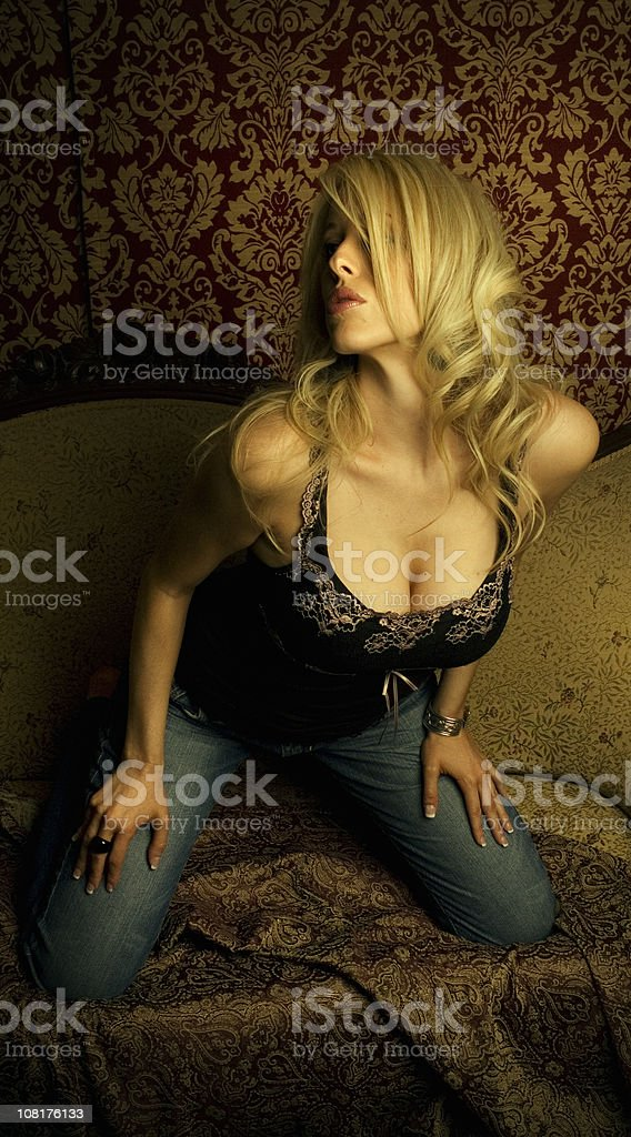 Young Woman Posing and Leaning Forward Provocatively royalty-free stock photo
