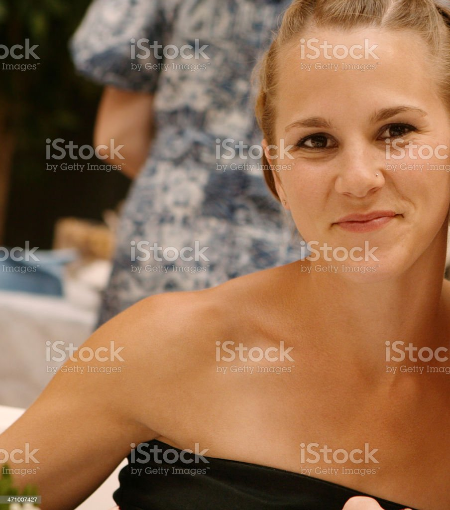 Young Woman Posing at Wedding Reception royalty-free stock photo