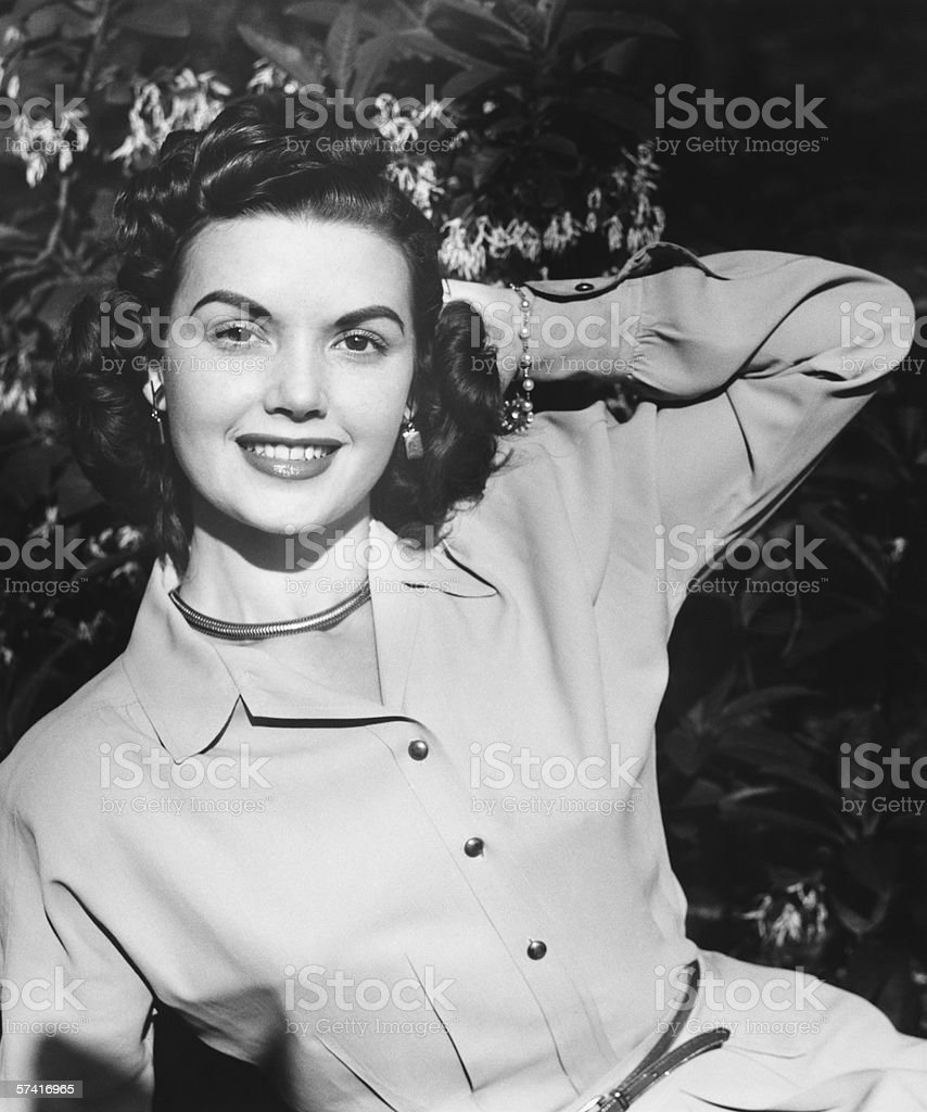 Young woman posing by blooming tree, (B&W), (Close-up), (Portrait) stock photo