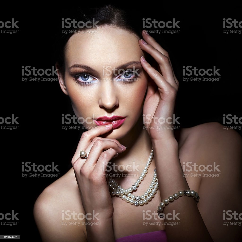 A young woman posing in a pearl necklace royalty-free stock photo