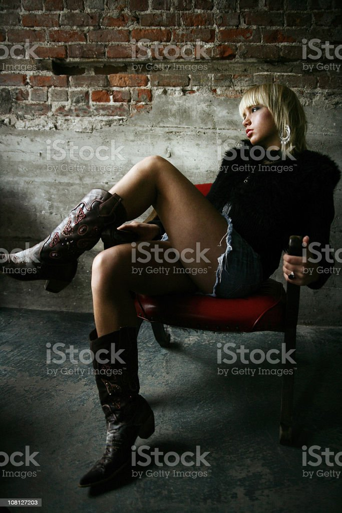 Young woman Posing in Chair royalty-free stock photo