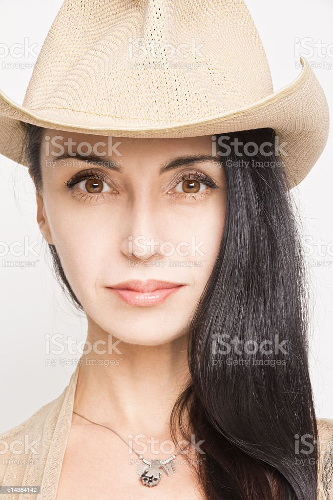Young woman posing in cowboy hat stock photo
