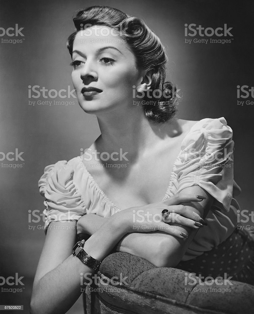 Young woman posing in studio, (B&W), portrait stock photo