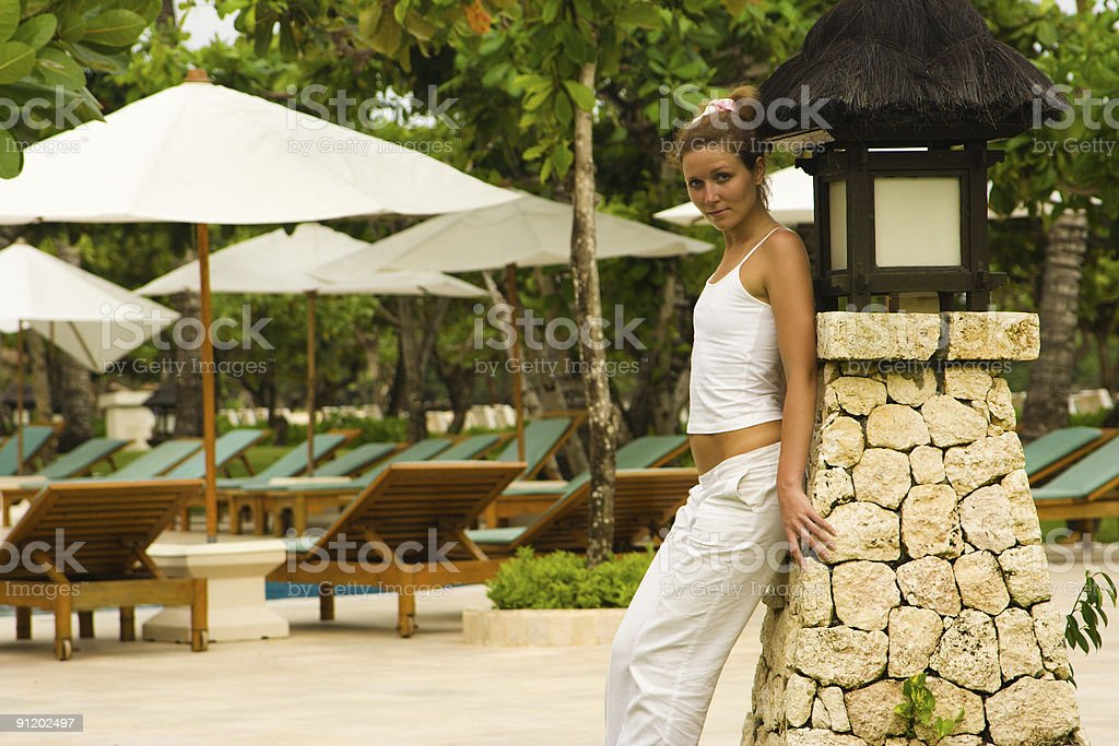 Young woman posing near the pool royalty-free stock photo