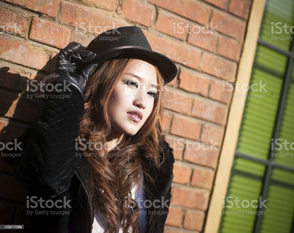 Young woman posing outdoors stock photo