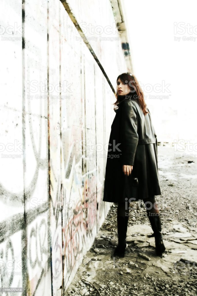 Young Woman Posing Outside Grunge Building royalty-free stock photo