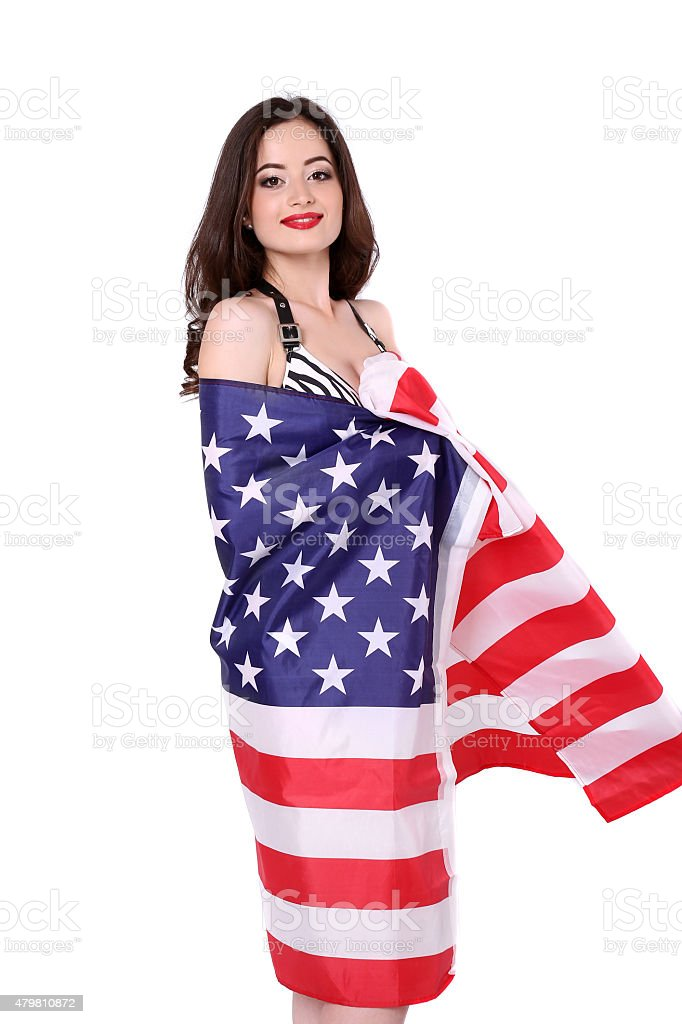 Young woman posing over american flag background royalty-free stock photo