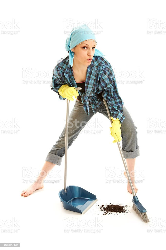 Young Woman Posing Sweeping Floor with Dust Pan stock photo