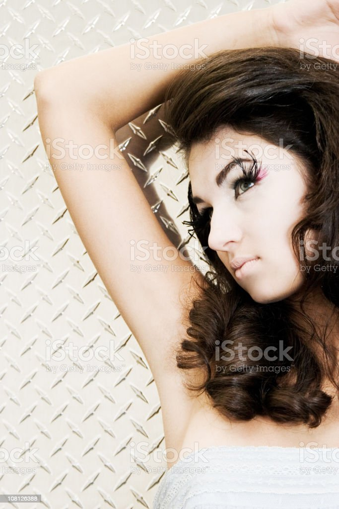 Young Woman Posing Wearing Feather Eyelashes and Make-up stock photo