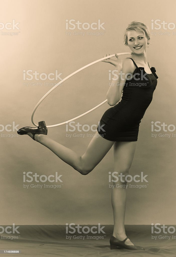 Young woman posing with a hoop for vintage style photograph stock photo
