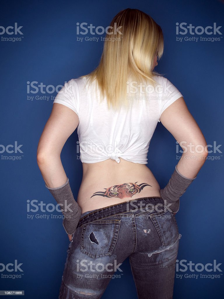 Young Woman Posing With Back Tattoo royalty-free stock photo