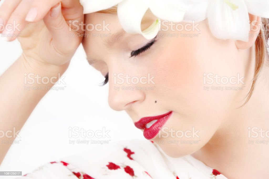 Young Woman Posing with Eyes Closed and Hand Against Forehead stock photo