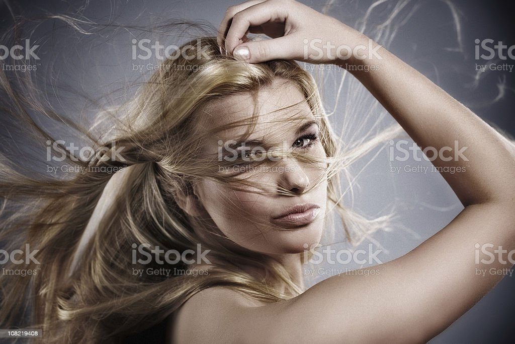 Young Woman Posing with Hair in Wind royalty-free stock photo
