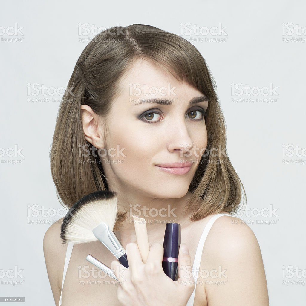Young woman posing with make-up accessories royalty-free stock photo