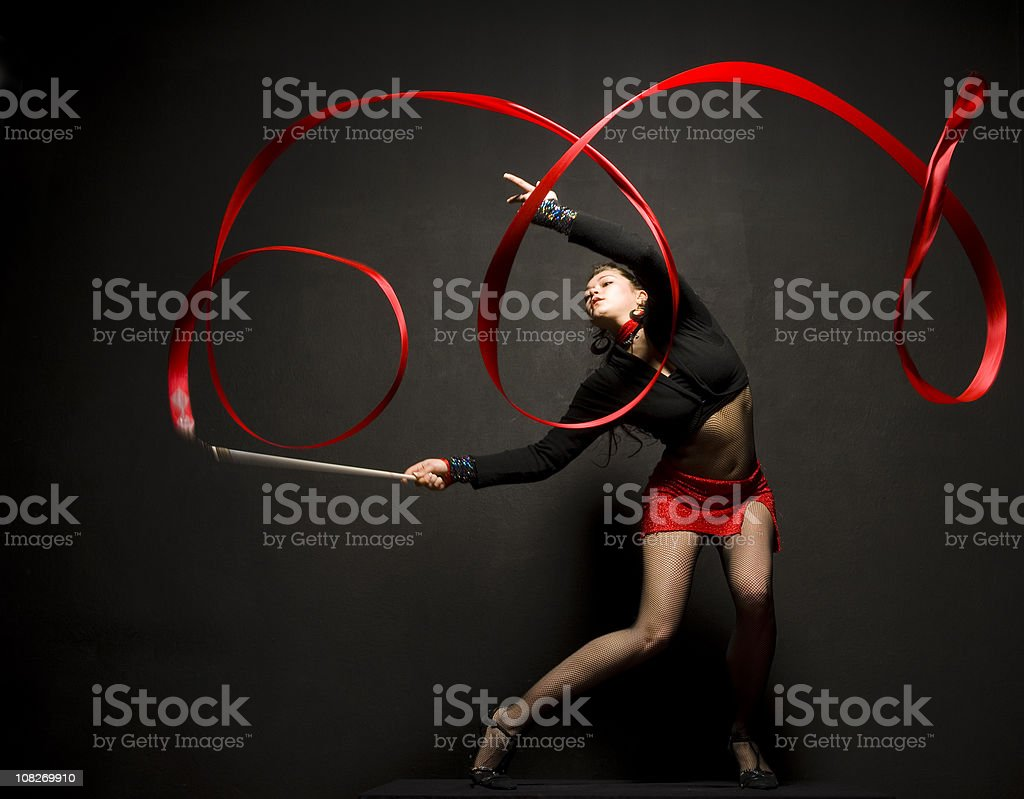Young Woman Posing with Ribbon Doing Rhythmic Gymnastics stock photo