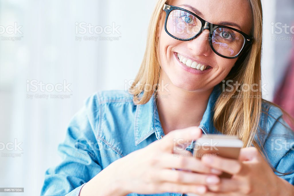 Young Woman Posing with Smartphone stock photo