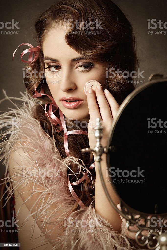 Young woman powdering face royalty-free stock photo