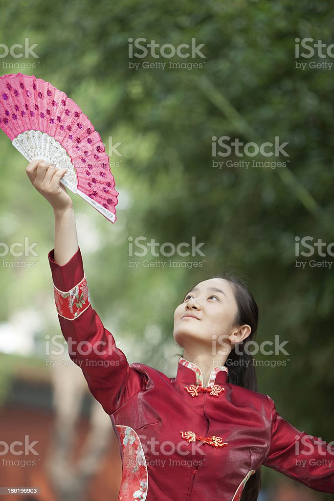 Young Woman Practicing Tai Ji With Traditional Chinese Fan royalty-free stock photo