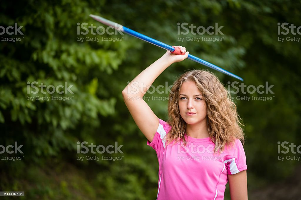 Young woman practicing throwing a javelin stock photo