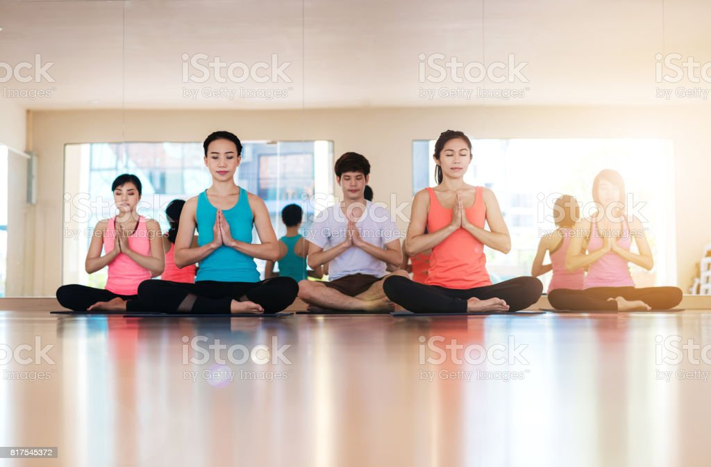 Young woman practicing yoga indoors.Yoga Practice Exercise Class...