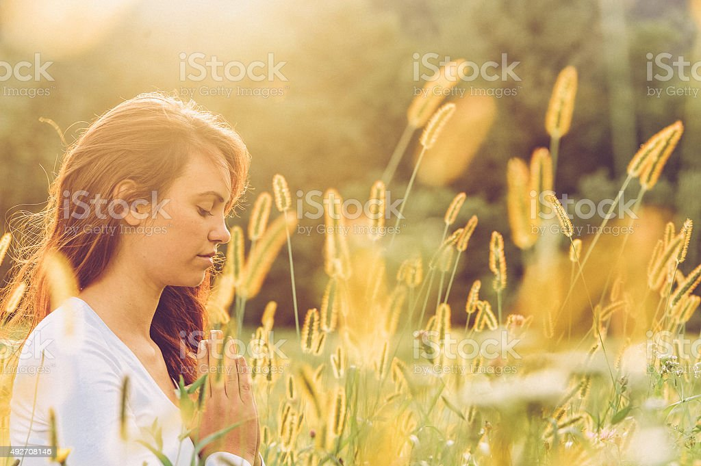 Young Woman Practicing Yoga Outdoors stock photo