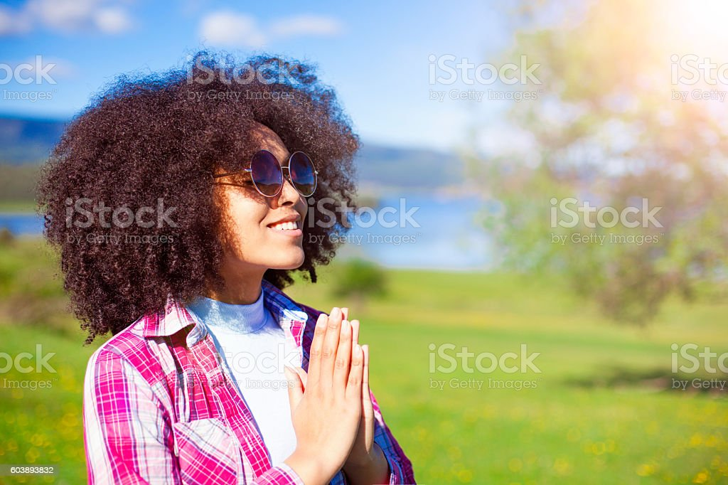 Young Woman Practicing Yoga Outdoors. stock photo