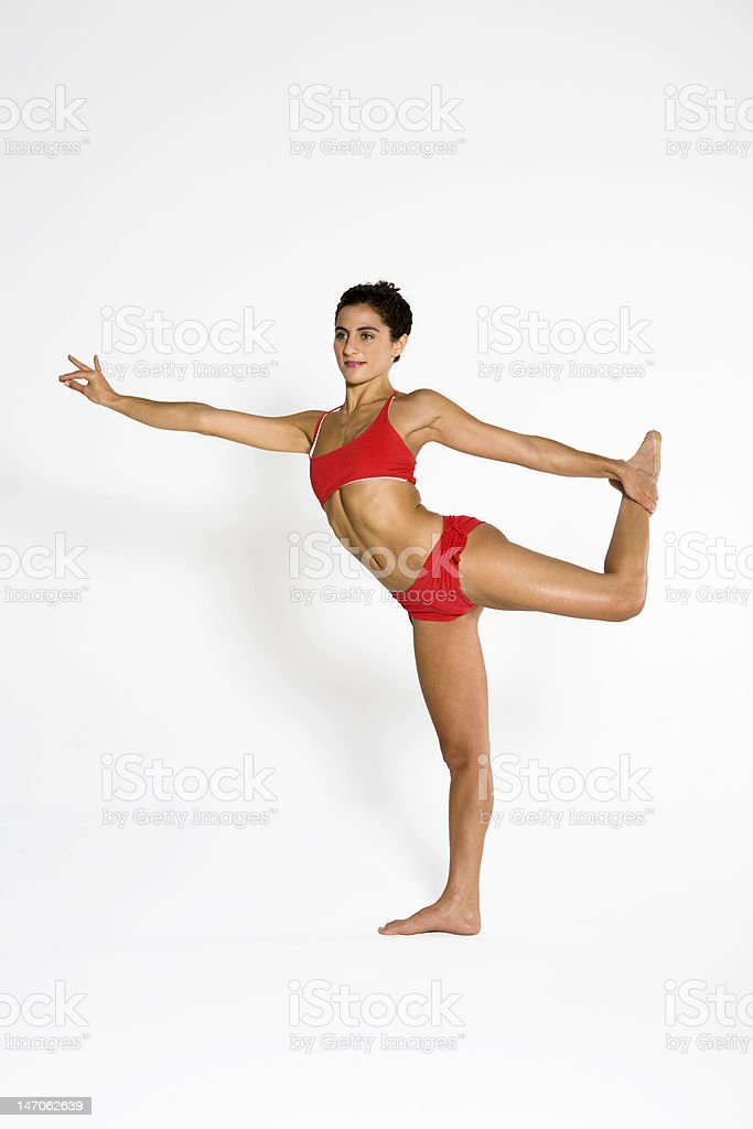 Young woman practicing yoga royalty-free stock photo
