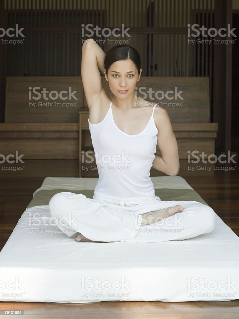 Young woman practising yoga royalty-free stock photo