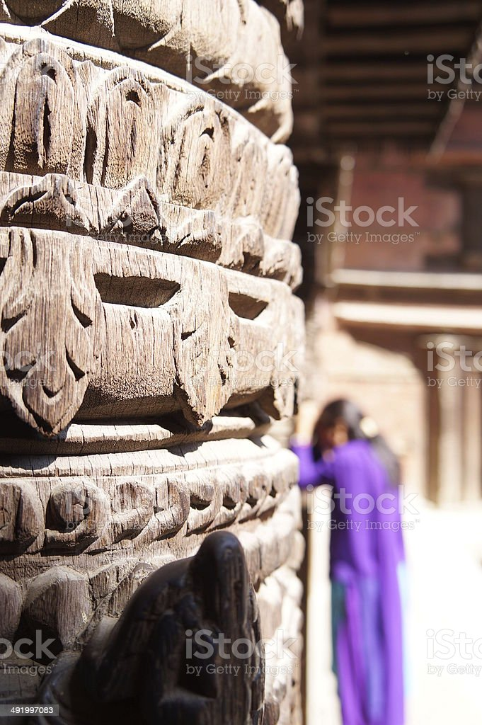 Young woman praying in Nepal temple stock photo