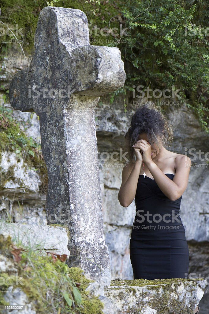 Young woman praying royalty-free stock photo