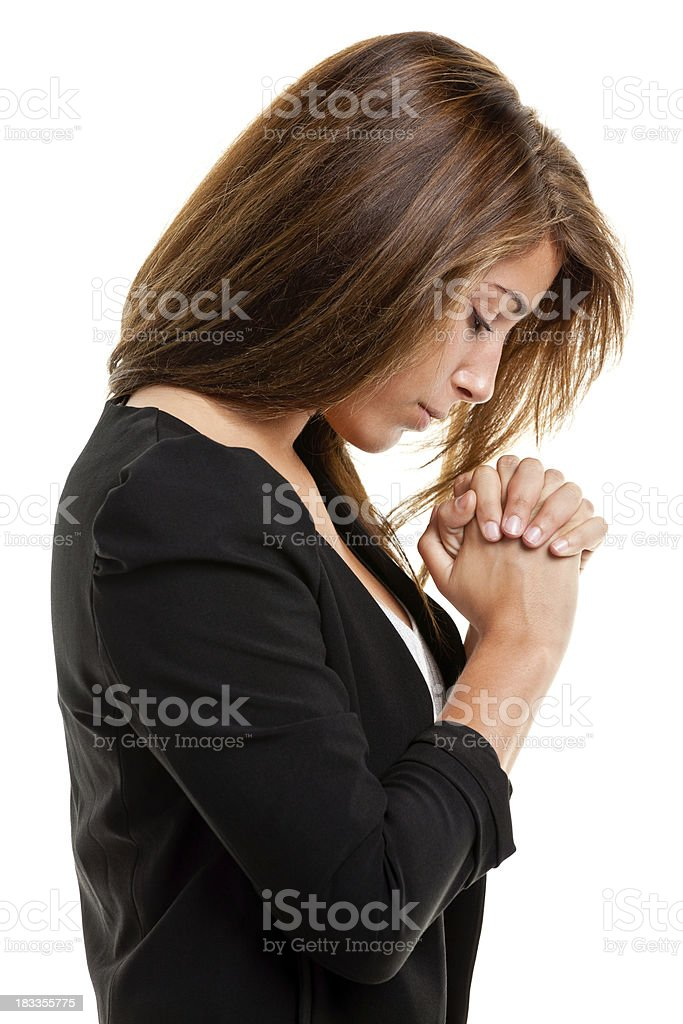 Young Woman Praying, Profile Side View stock photo