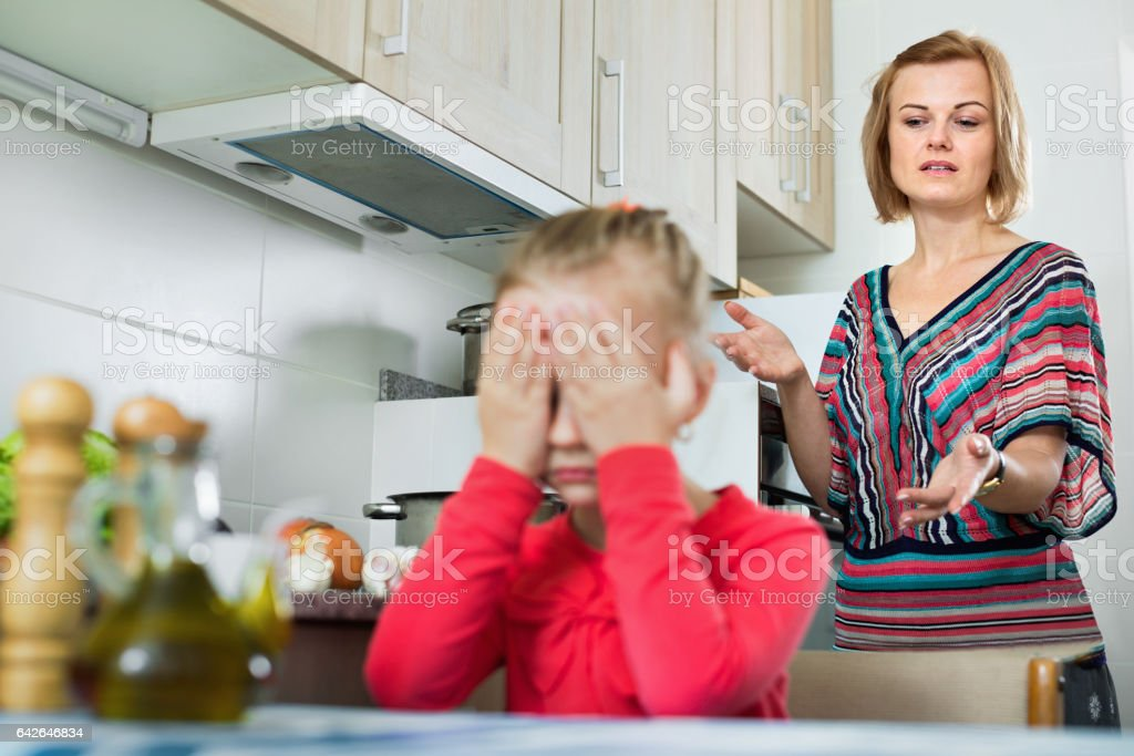 Young woman preaching little daughter stock photo