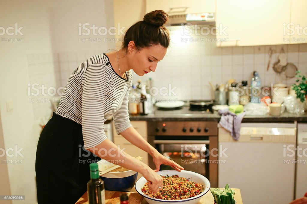 Young woman preparing food on the table stock photo