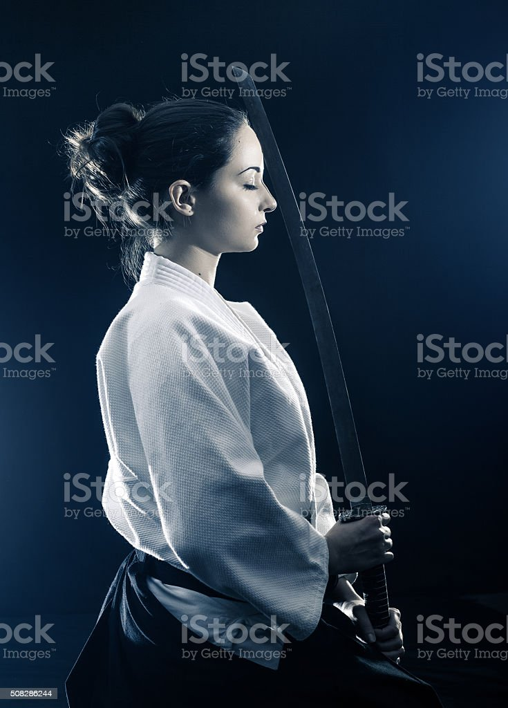 Young woman preparing for aikido training stock photo