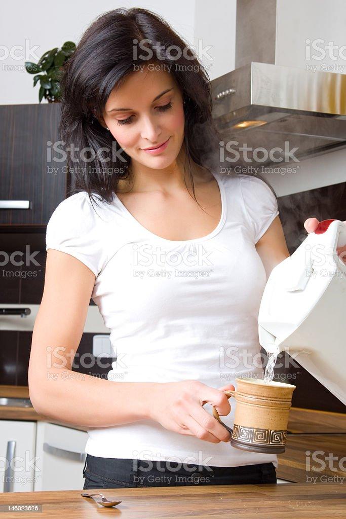Young woman preparing tea stock photo