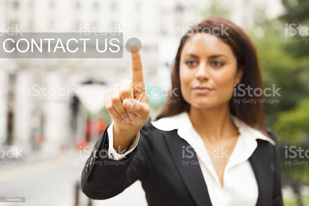 Young Woman Presses CONTACT US Button royalty-free stock photo