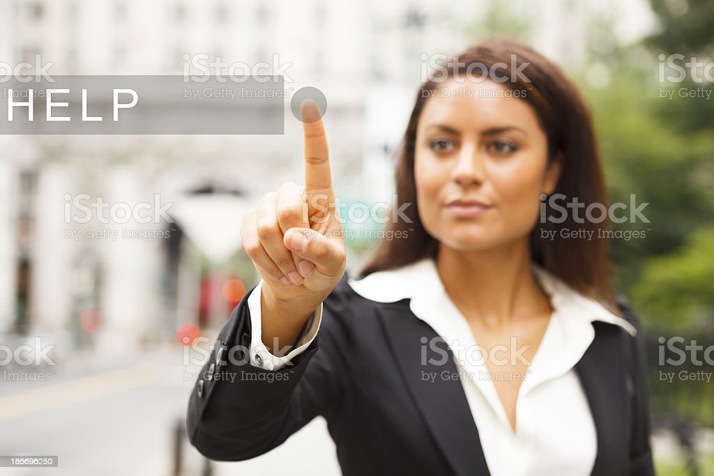 Young Woman Presses HELP Button royalty-free stock photo