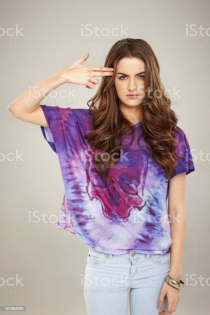 Young woman pretending to blow up her head royalty-free stock photo