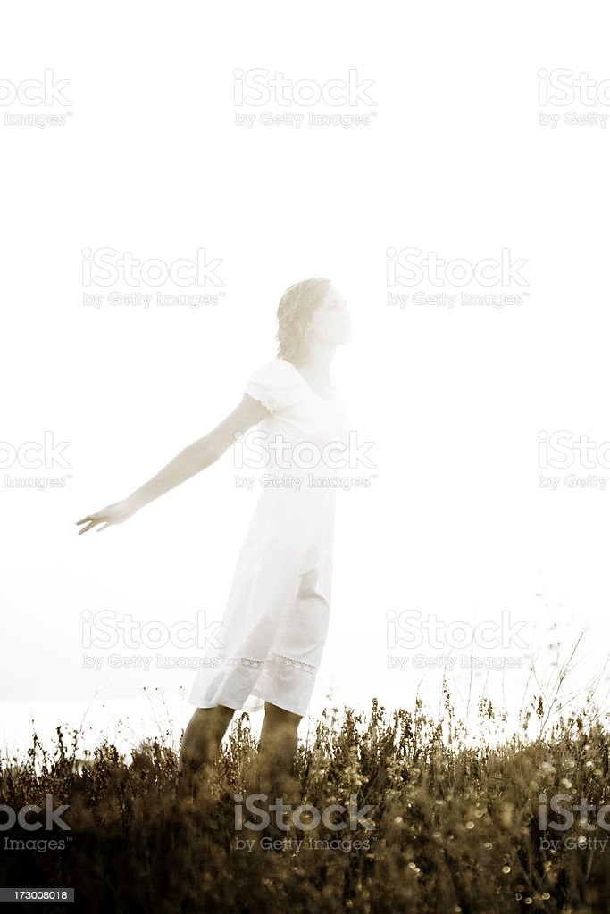 Young Woman Pretends to Fly stock photo