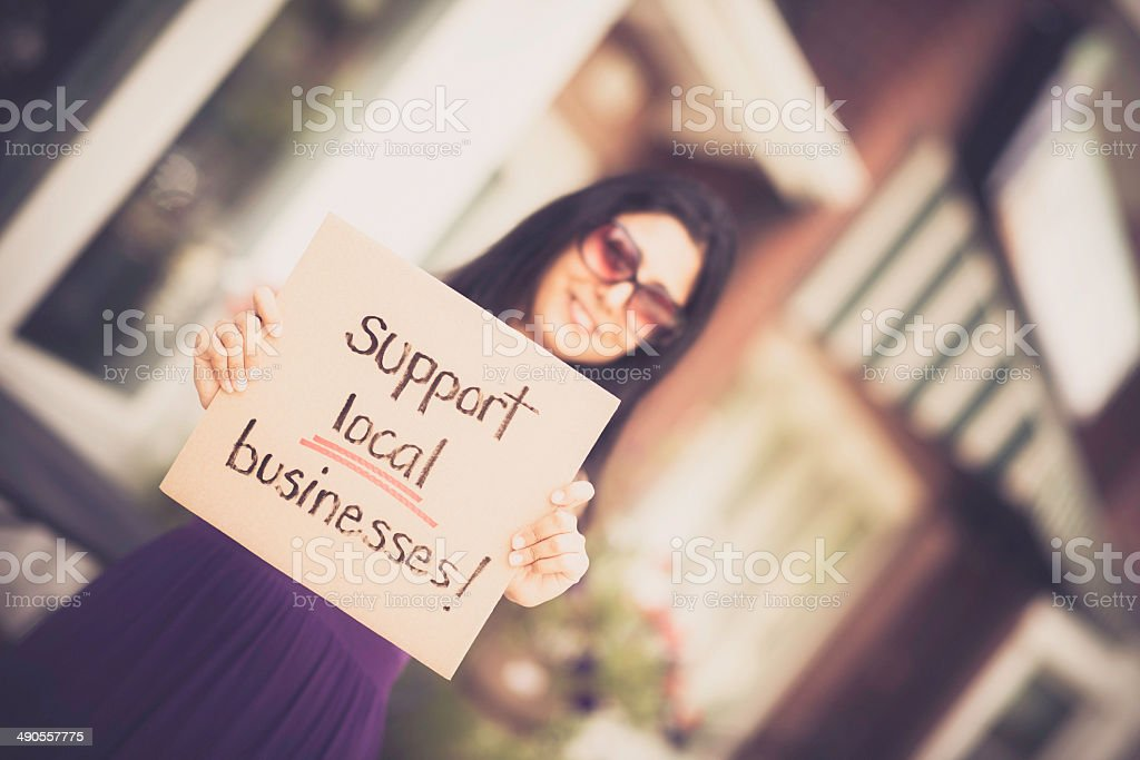 Young Woman Promoting Small Businesses royalty-free stock photo