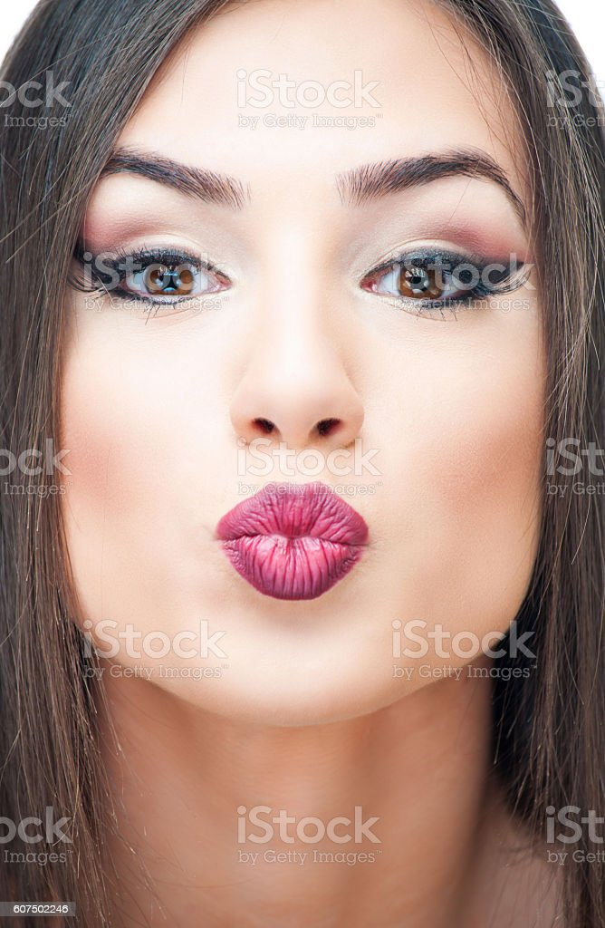 Young woman puckering stock photo