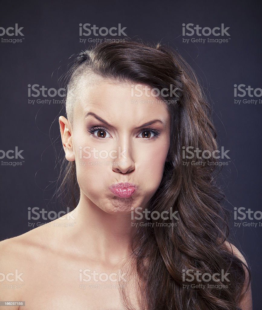 Young Woman Puffs Cheeks stock photo