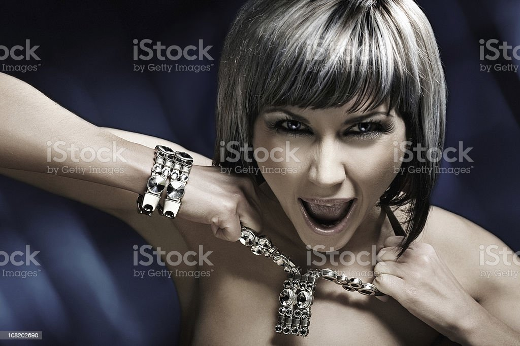 Young Woman Pulling on Necklace royalty-free stock photo