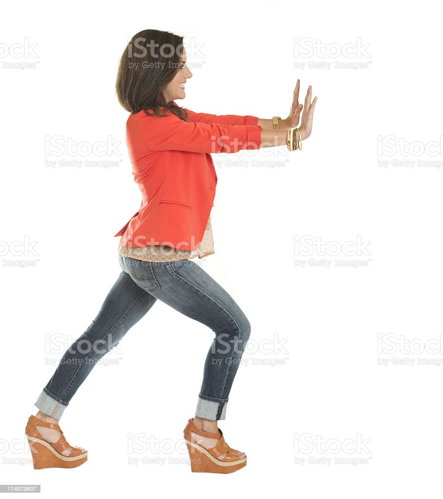 Young Woman Pushing stock photo
